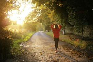 woman walking on pathway during daytime